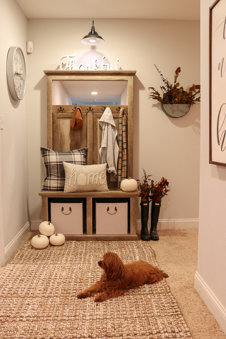 Decorate your entryway with puppy and fall pillows and decor