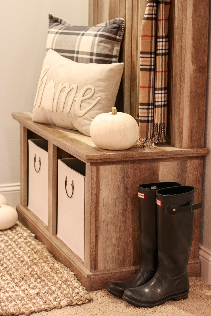 Handy Storage Bins Help Tidy up a Messy Entryway with pumpkins and boots