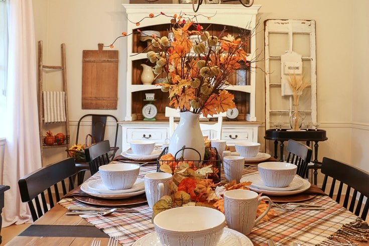 We updated our fall table with warm colorful botanicals, textured plaid linens and cozy scented candles.
