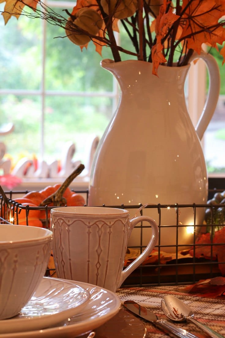 Create a warm and cozy entertaining space with an affordable pumpkin spice inspired fall dining room update.