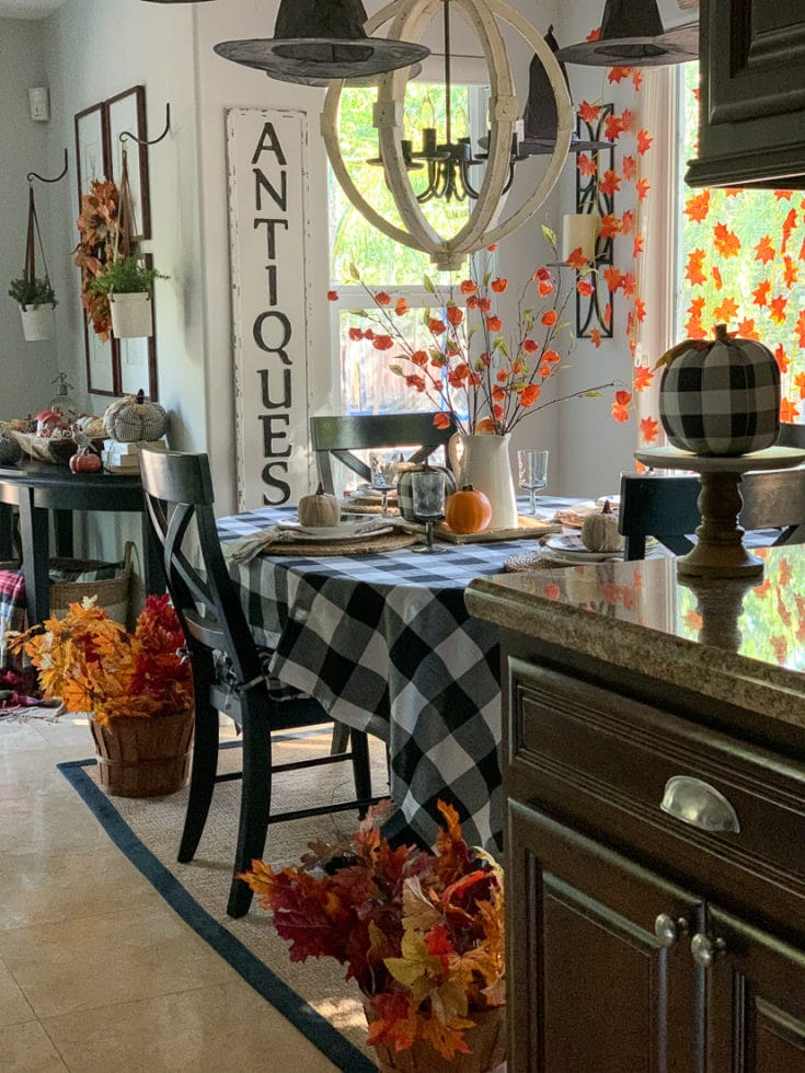Affordable Halloween party ideas with Floating witch hats and autumn leaf garland. It's festive and easy to create this look! We show you how!