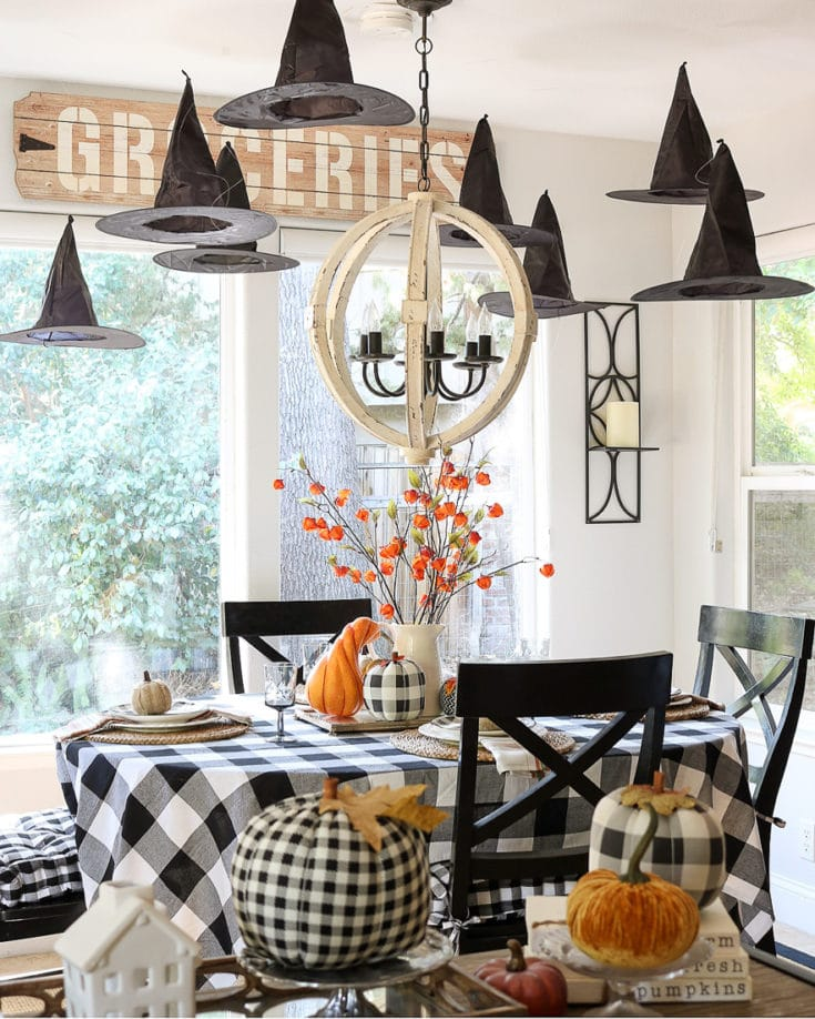 Easy and Affordable tips for a black & white and orange theme Halloween table. We are sharing our easy tips!