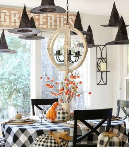 Floating witches hats and buffalo plaid make this festive table Halloween ready!