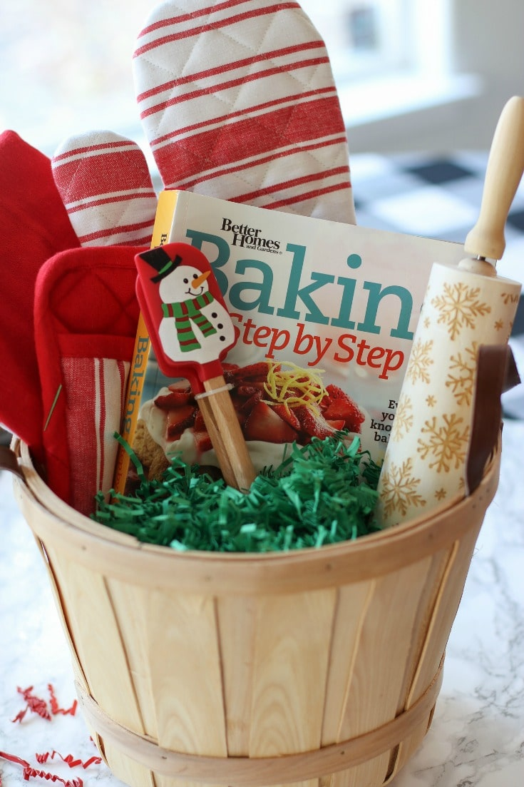 festive Christmas baking essentials included in this baking gift basket with snowflake rolling pin and snowman spatulas