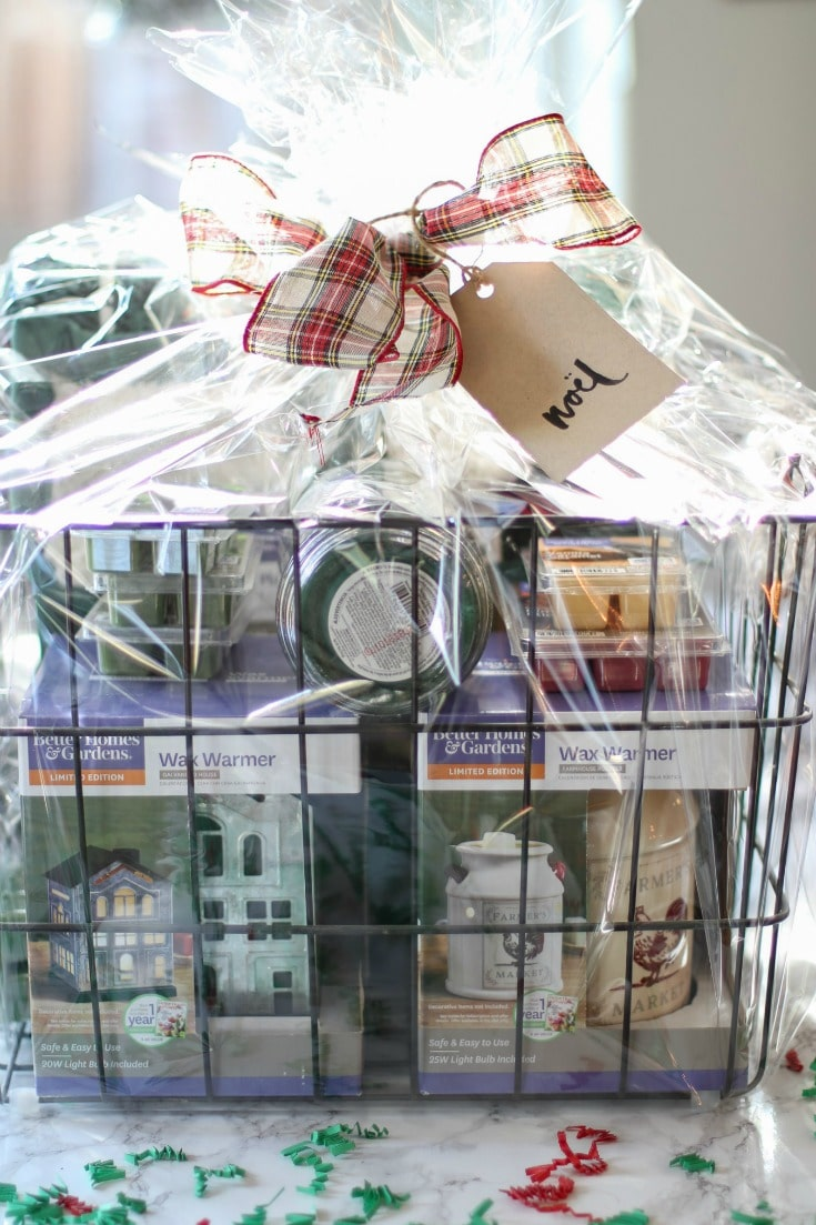 this candle lover's basket is perfect for all candle lovers and includes wax warmers, wax melts and full-sized candles and a cozy blanket