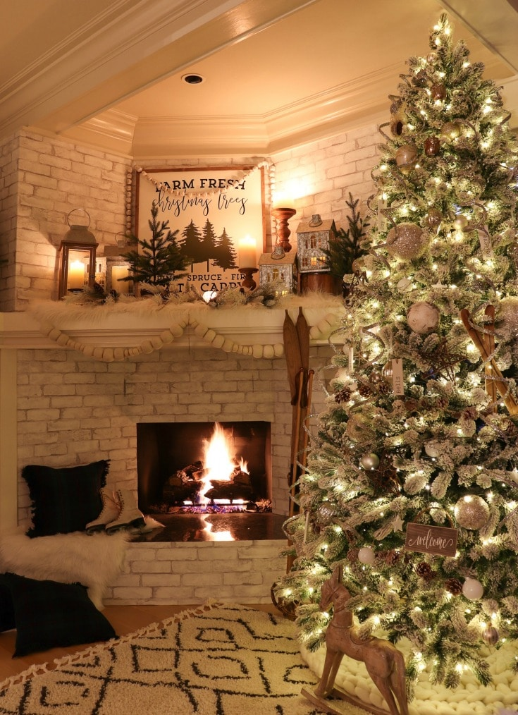 fireplace setting with pom-pom mantle garland and silver tree decorations