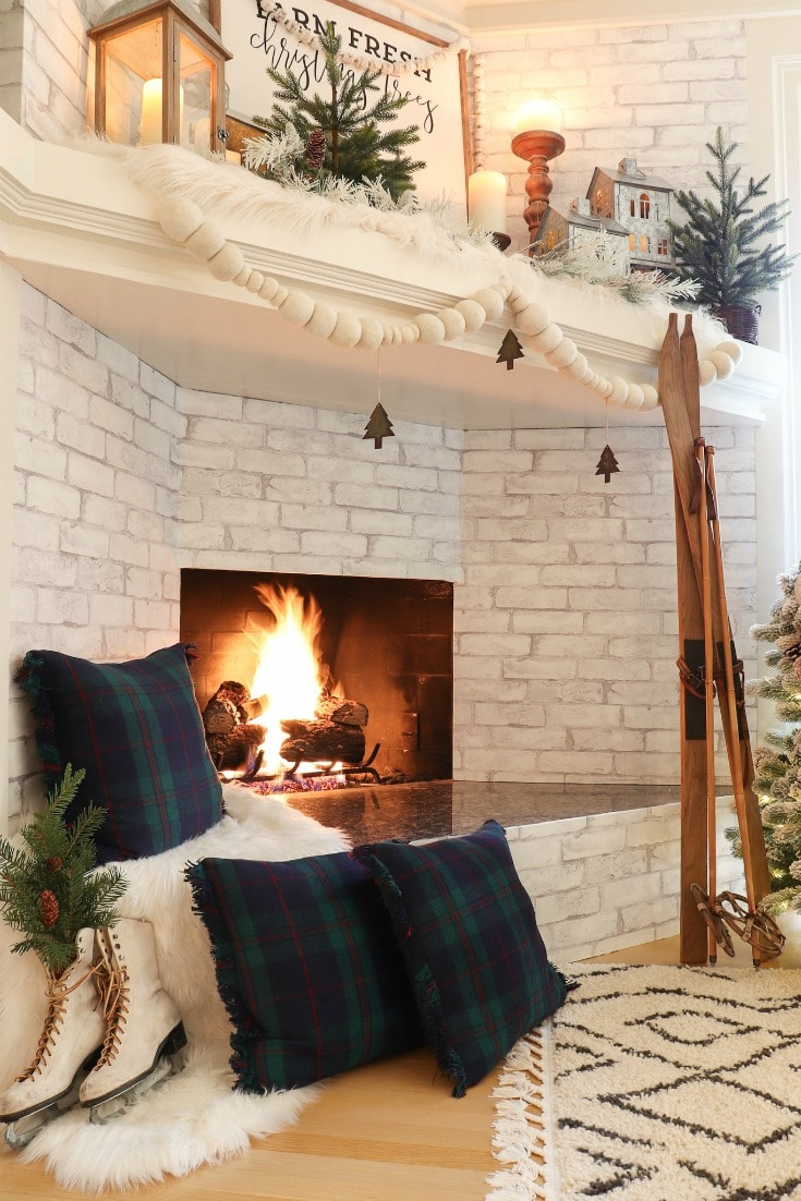 fireplace decor with farmhouse plaid pillows and vintage skis