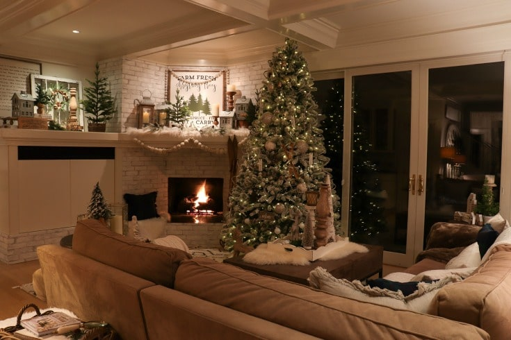 family room white Christmas themed holiday decor with farmhouse elements