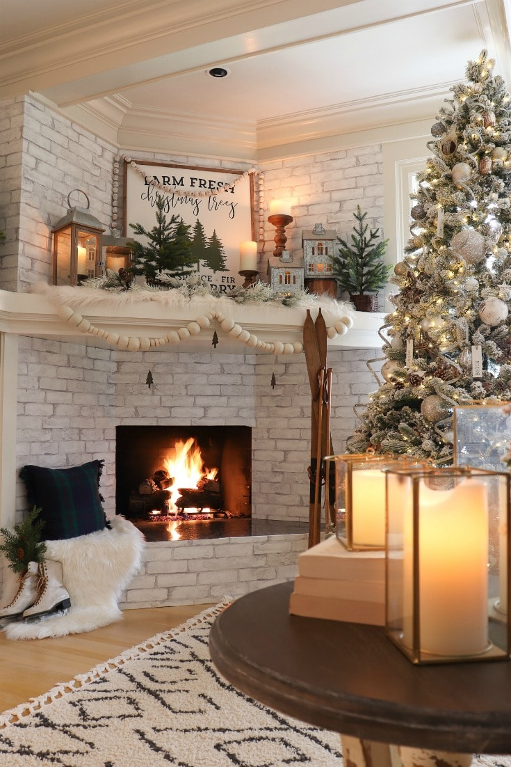 cozy white Christmas mantelpiece with mood lighting and farmhouse tree sign