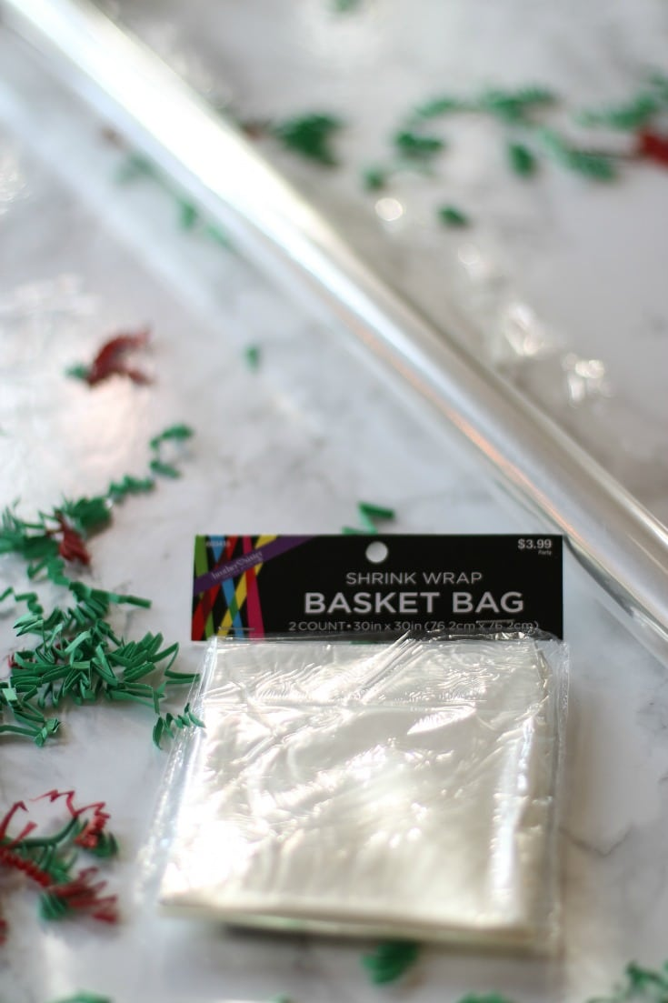 wrap your christmas gift baskets in clear cellophane and tie with festive red and green ribbon