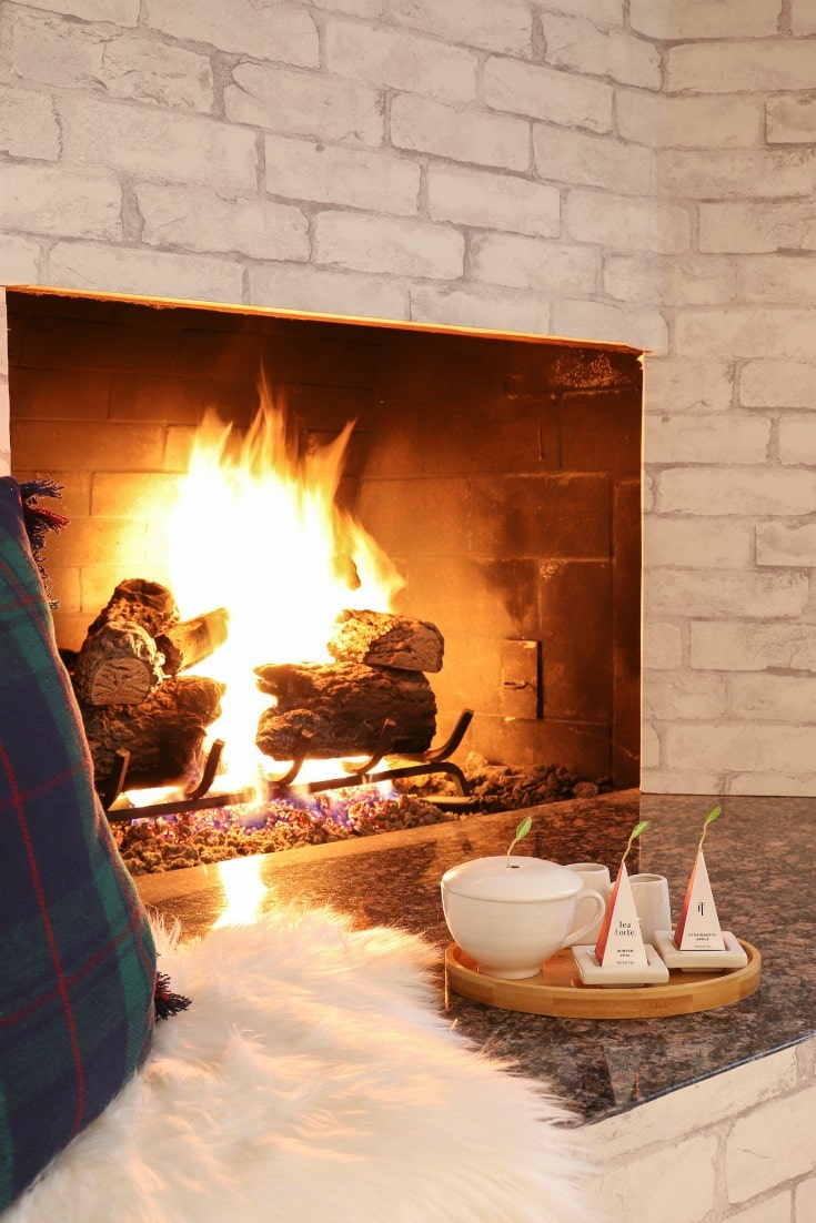 snuggle up by the fire with your hot cup of tea
