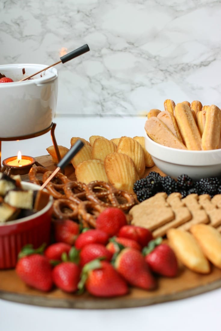 chocolate fondue charcuterie boards are not complete without a good balance of sweet and savory elements