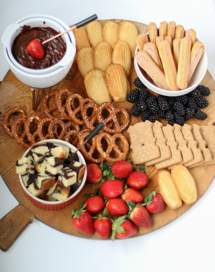 this chocolate fondue charcuterie board is the perfect crowd pleaser for entertaining