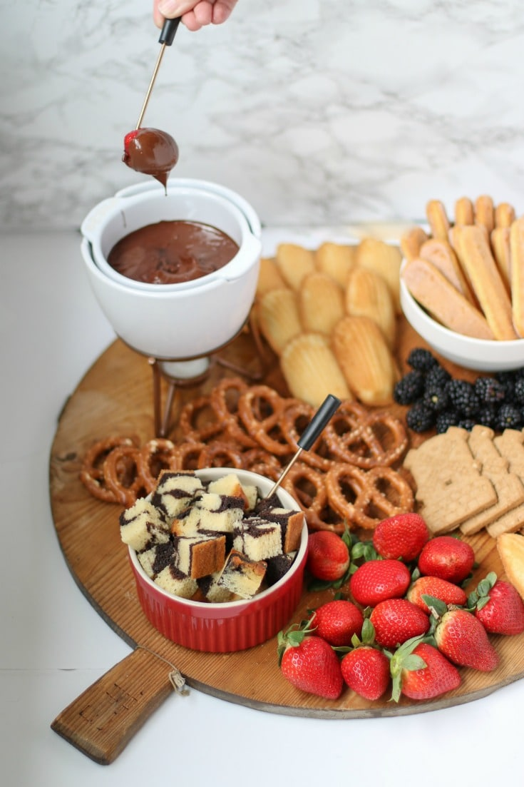 dip strawberries in chocolate for your chocolate fondue charcuterie board
