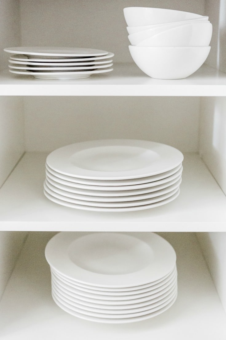 clean white dishes sitting on white shelves