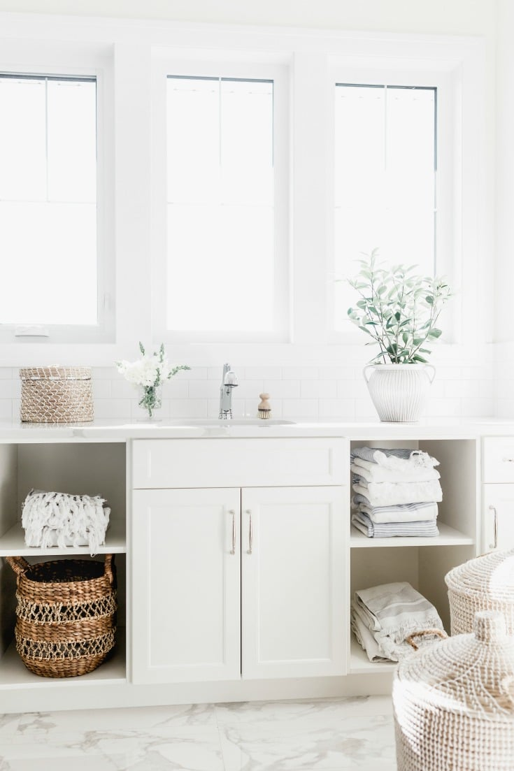 clean white bathroom with towels and sink
