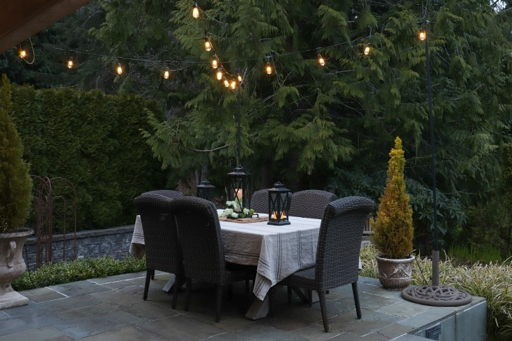 beautiful outdoor patio setting with string lights and dining table