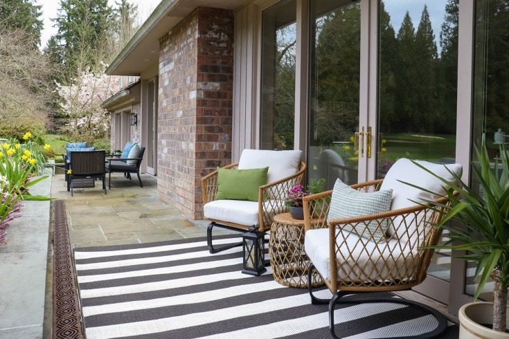 striped rug and two wicker chairs from better homes & gardens at walmart