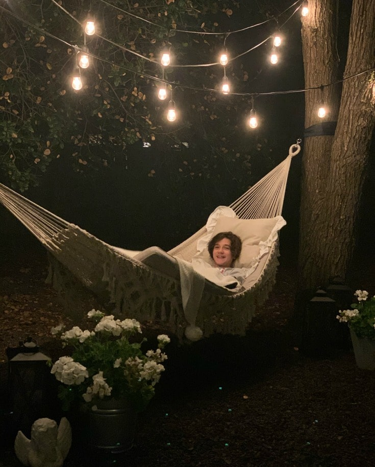 my son reese hanging out in our new DIY hammock