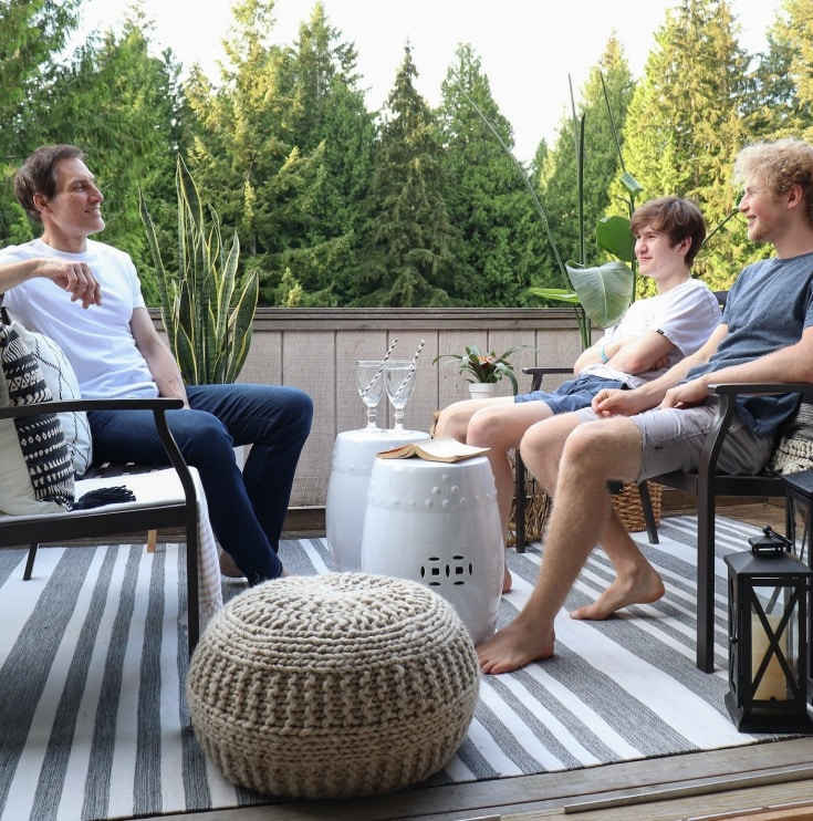 father and sons enjoying their new small patio space
