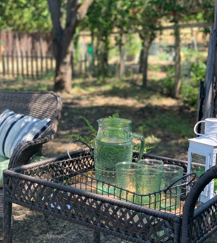 outdoor bar cart with green glassware