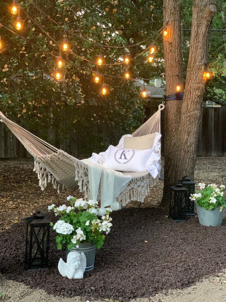DIY hammock project to liven up your backyard with overhead string lights