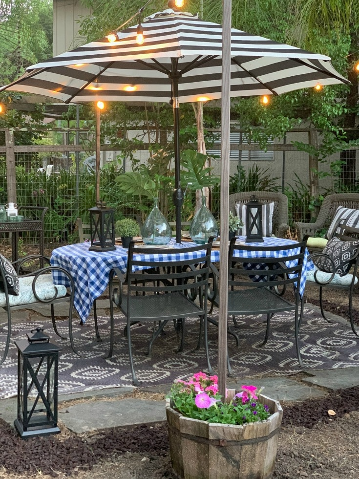 outdoor dining table with overhead string lights