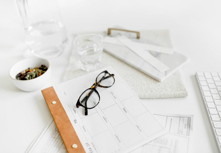 desk with glasses and calendar