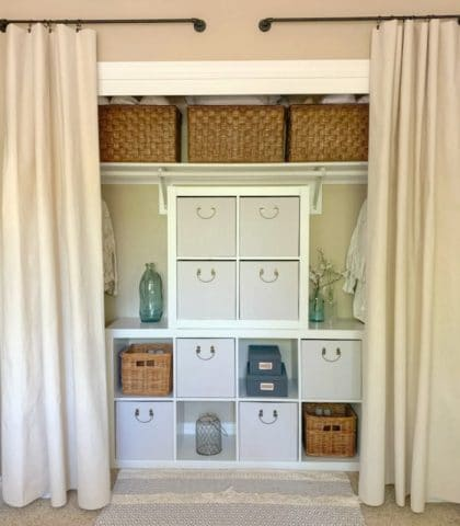 Organized your closet with curtains and cube organizers