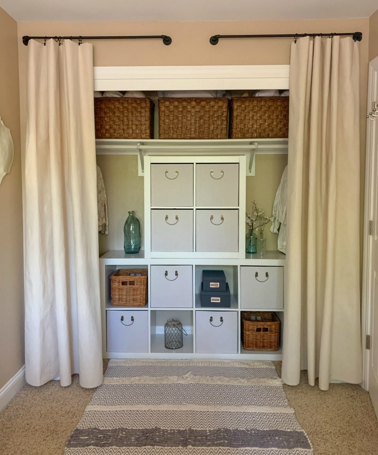 finished no door closet makeover organization using cube organizers and curtains