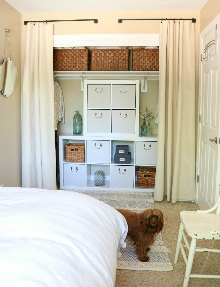 Closet makeover with curtains and cube organizers is pretty and functional