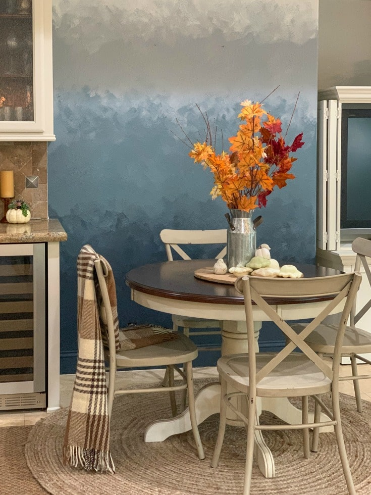 ombre wall with table and chairs and fall leaves