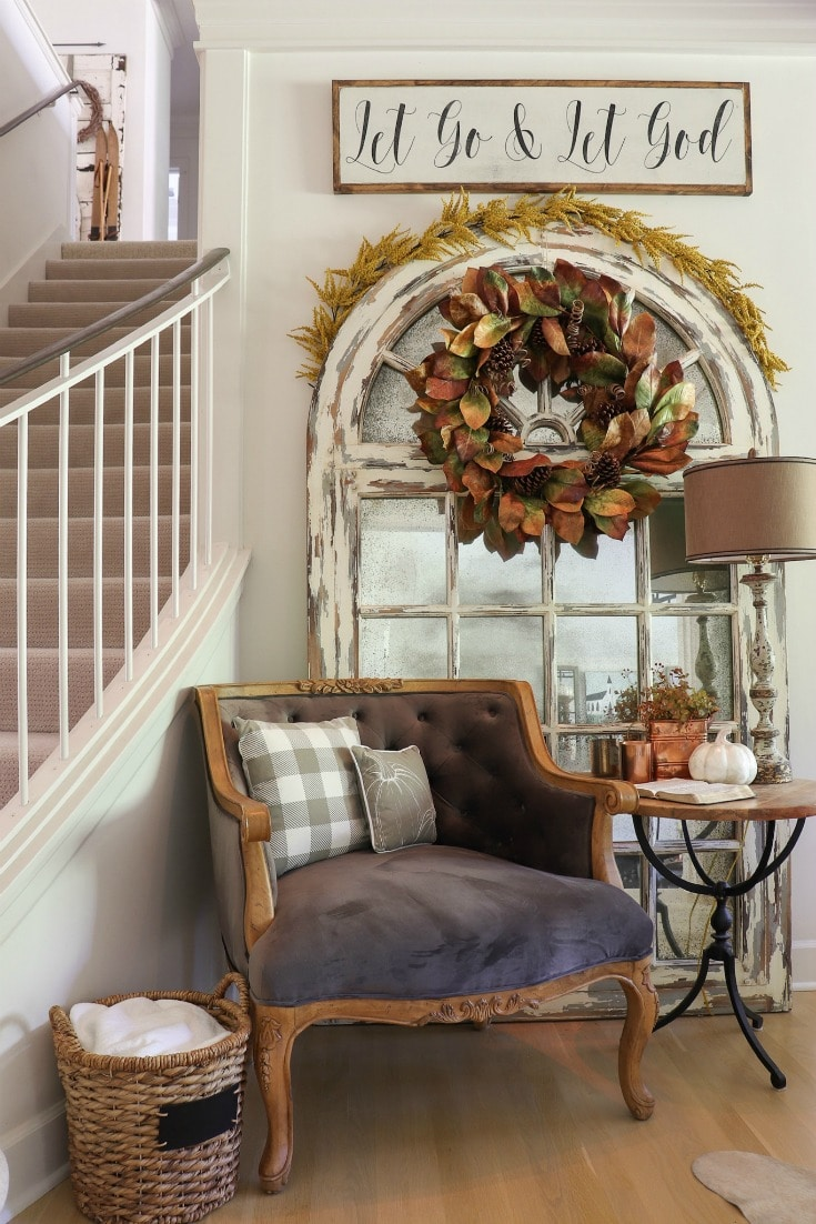 fall decor corner with reading chair and mirror