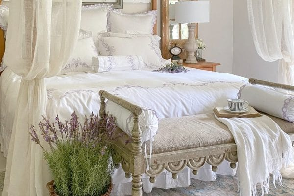 white farmhouse bed with cozy bedding for better sleep