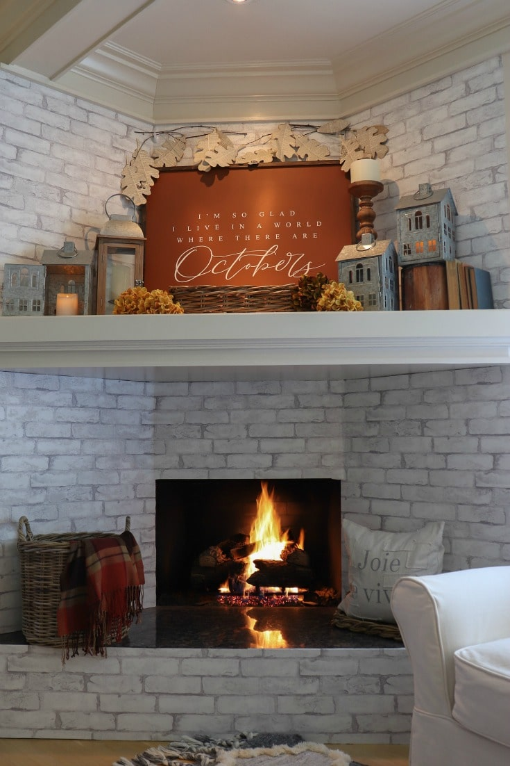 Warm colors and rich hues create a warm inviting fall fire place and cozy mantel decor