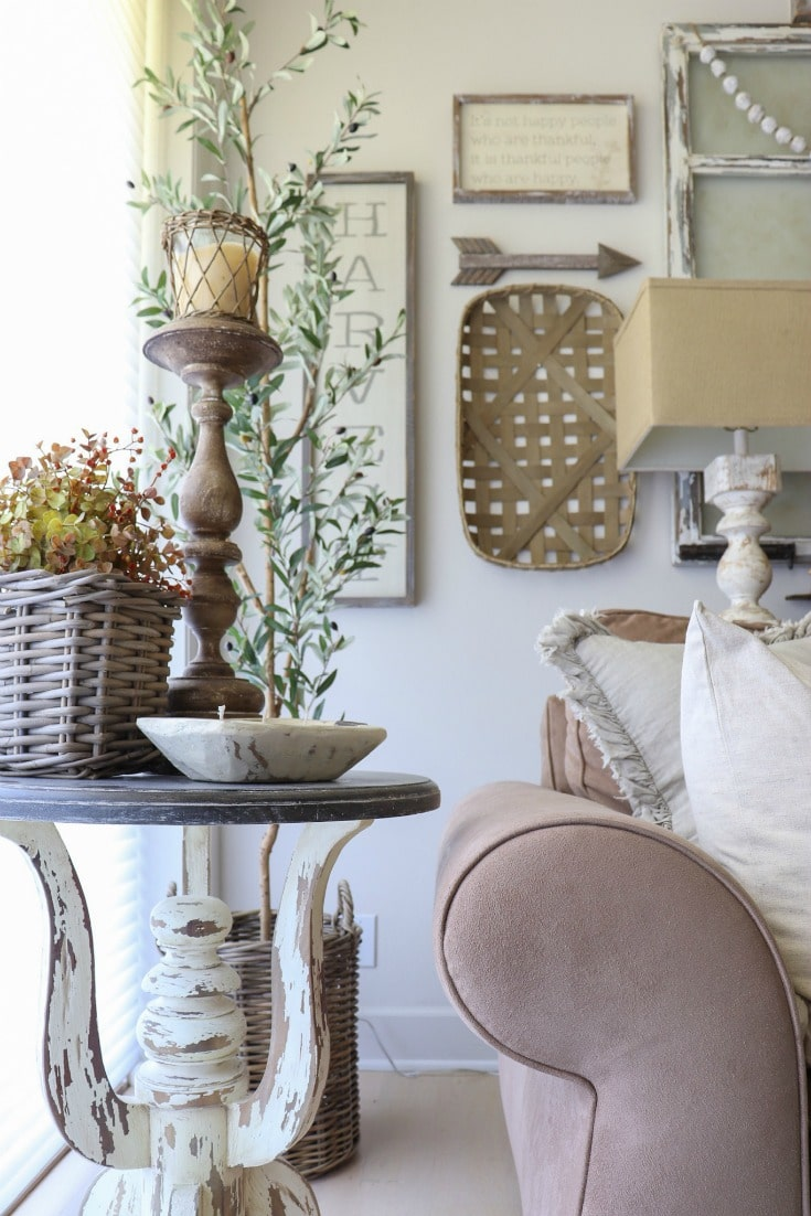 Neutral details, and a collection of textures add warmth to this farmhouse fall family room decor