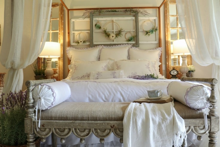 beautiful white bed with comfy pillows and blankets