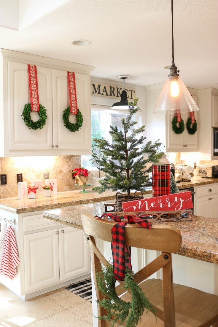 holiday Christmas kitchen decorated with wreaths