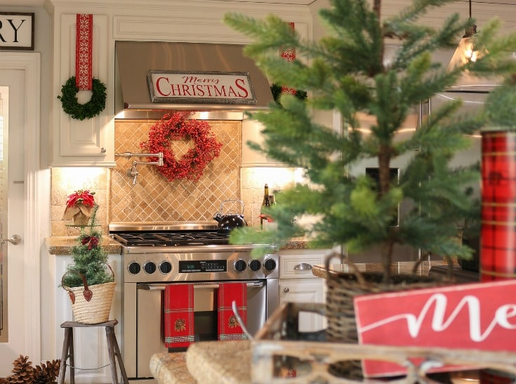 holiday kitchen with wreaths on cabinets