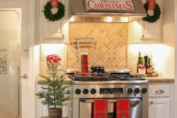 Holiday Kitchen decorated with pops of red mini Christmas trees and festive mini wreaths