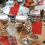 Homemade granola in mason jars tied with festive bows this Christmas