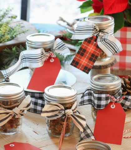 mason jars filled with homemade granola tied with festive ribbons are perfect Christmas gifts