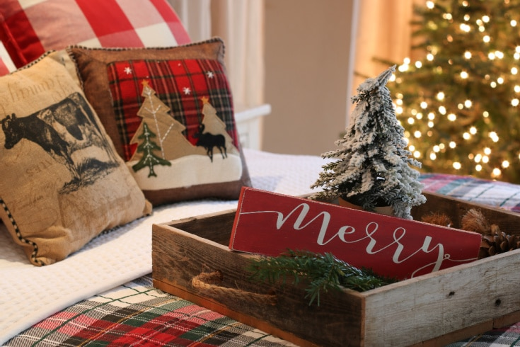 farmhouse christmas bed with red plaid bedding and rustic tray on top
