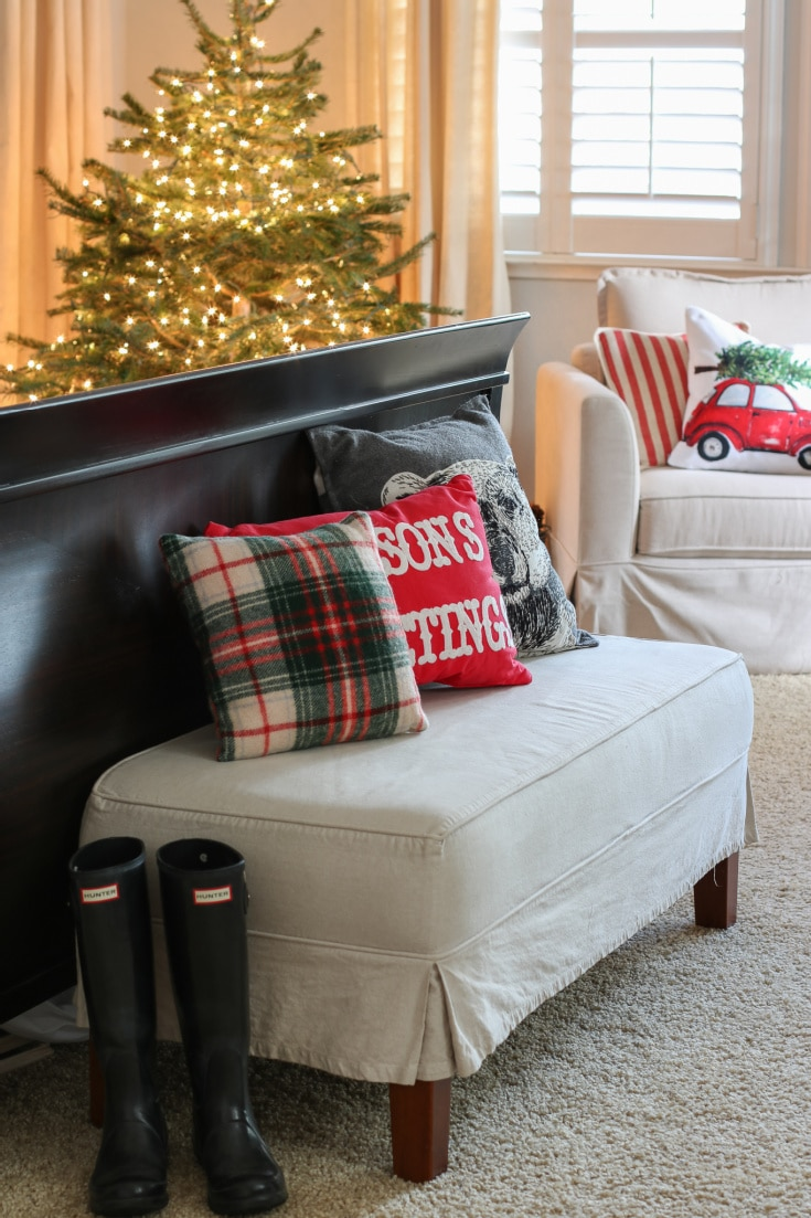 white bench at end of bed with Christmas pillows