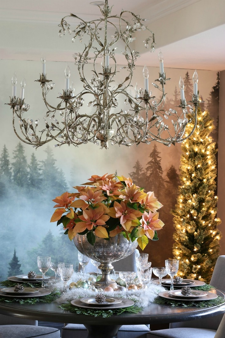 natural dining room decor with elegant crystal chandelier and greenery