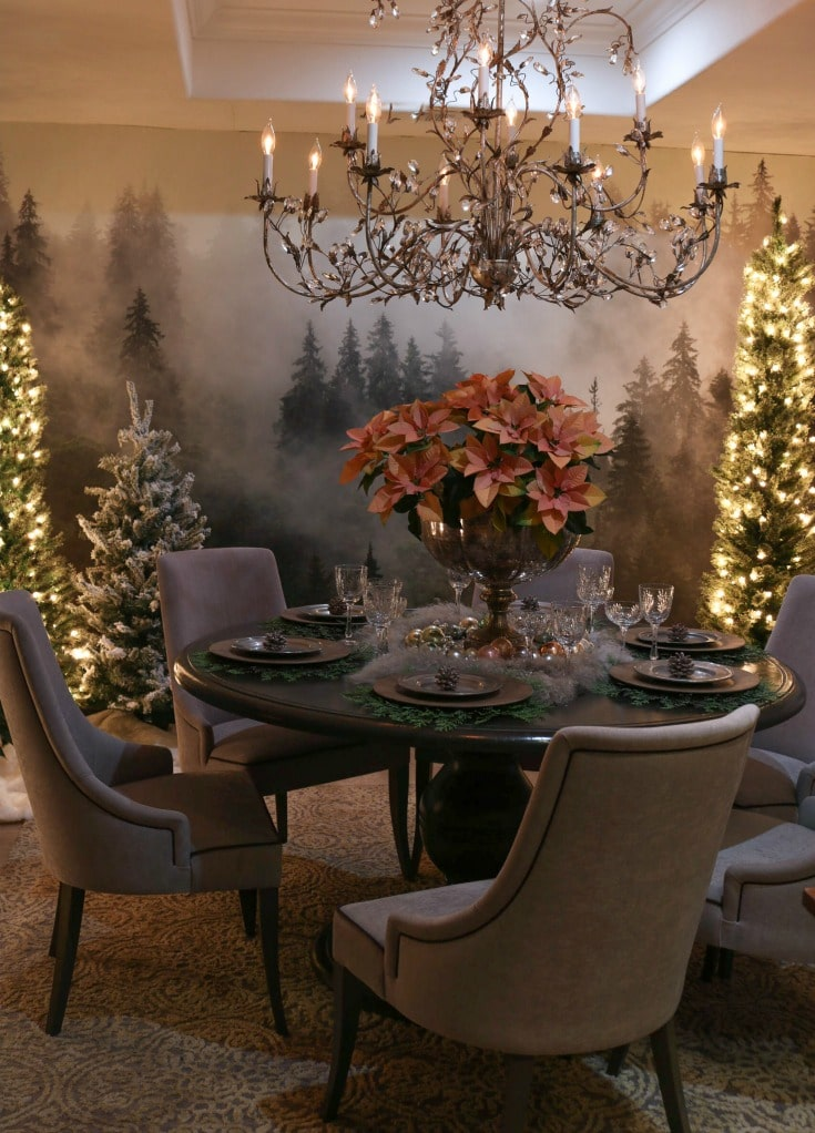 intimate festive dining room experience created with twinkling Christmas tree lights, poinsettias and crystal chandelier