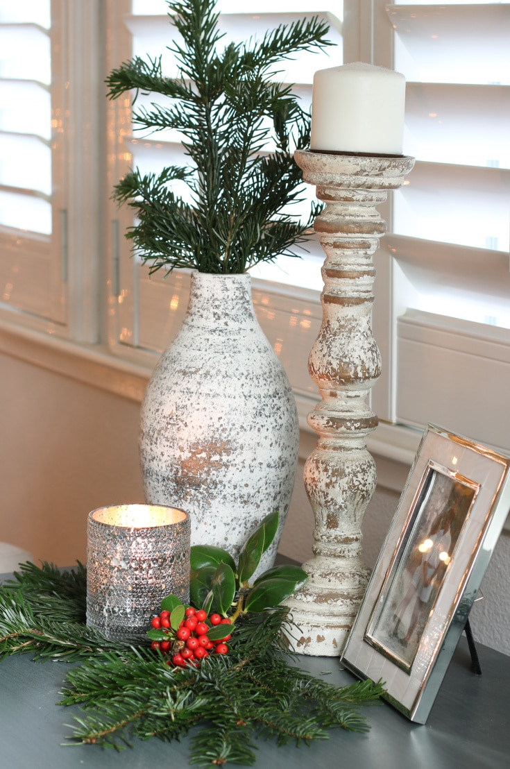 Christmas side table with greenery and candles