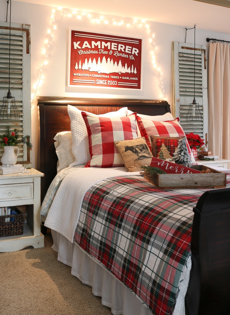 red plaid master bed decorated with rustic tray and festive pillows