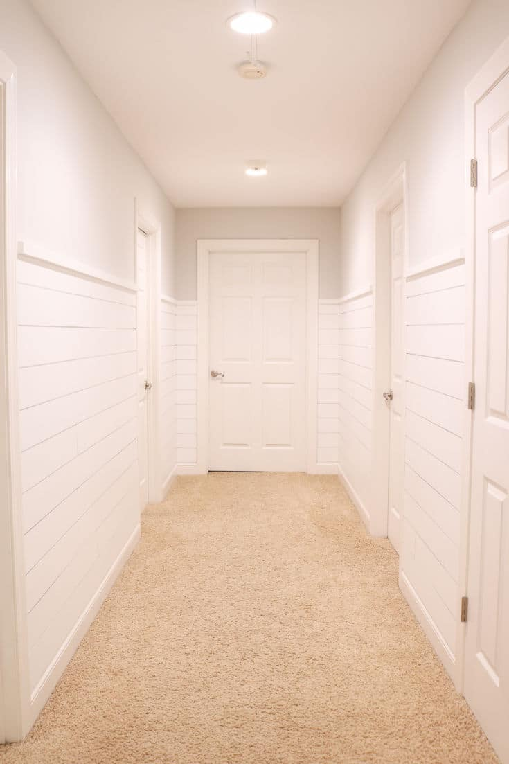 empty hallway with white shiplap on walls