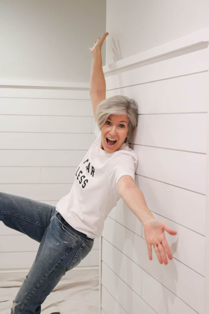 shiplap walls with woman posing in front